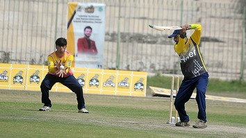 A wicket-keeper catches the ball at the first-ever Zalmi Madrassa Cricket League in Peshawar August 31. [Shahbaz Butt]