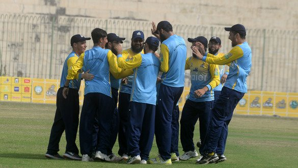 Members of the Al-Hilal Challengers celebrate the fall of a wicket during a match in Peshawar August 31. [Shahbaz Butt]
