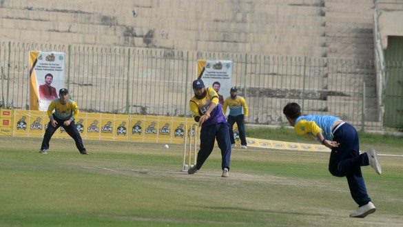 A bowler of the Al-Hilal Challengers is shown in Peshawar August 31. [Shahbaz Butt]