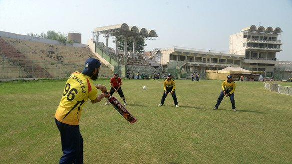 Members of the Al-Khair Riders practice before a match during the Zalmi Madrassa Cricket League in Peshawar August 31. [Shahbaz Butt]