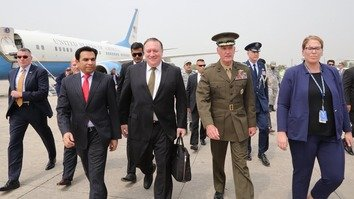 US Secretary of State Mike Pompeo (holding briefcase) and US Joint Chiefs of Staff Chairman Gen. Joseph Dunford arrive in Islamabad for talks September 5. [Twitter/Secretary of State Mike Pompeo]