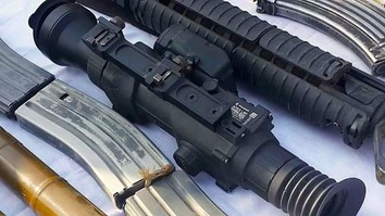 Russian-made rifle scopes shown in photo were seized from Taliban militants during an operation in Farah Province last September. [Farah governor's press office]