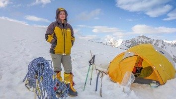 Uzma Yousaf stands near her camp during her expedition to Mt. Spantik (Golden Peak) in Gilgit-Baltistan in 2017. [Uzma Yousaf]