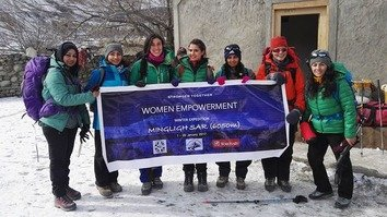 A group of female mountaineers pose for a photograph before starting their 6,000-metre climb of Peer Peak in Gilgit-Baltistan in January 2017. [Pakistan Youth Outreach Foundation]