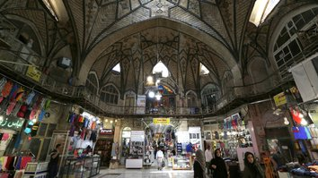 Iranians walk inside Tehran's ancient Grand Bazaar in Tehran on July 28, 2018. [Atta Kenare/AFP]