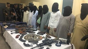 Pakistani forces display arrested suspected terrorists, weapons and ammunition on June 19, 2017, in Punjab Province as part of Operation Radd-ul-Fasaad. [Pakistan Army]