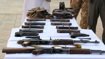 A group of militants surrender their weapons and ammunition at headquarters of Kunduz provincial police on September 23. [Hedayatullah]
