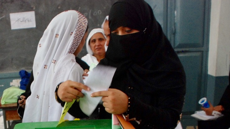 A woman is seen casting her vote at a polling station in the July 25 general election in Peshawar. A large number of voters in Peshawar and Dera Ismail Khan voted October 14 for the family members of victims of suicide attacks to show their support to those who stand against terrorism. [Javed Khan]