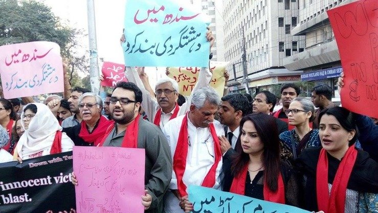 Civil society activists are seen protesting in Karachi last December against the brutality of Tehreek-e-Taliban Pakistan (TTP) militants. [Zia Ur Rehman]