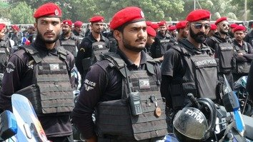 Karachi police October 13 patrol a public gathering. After suffering from internal strife and a government crackdown, the TTP has been attempting to re-establish its network and overcome its internal differences. [Zia Ur Rehman]