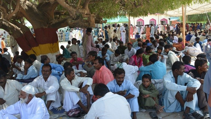 Thousands attend a festival at Sant Nenu Ram Ashram in Islamkot. The shrine has been providing free food to all visitors for decades regardless of their religion or race. [Zia Ur Rehman]