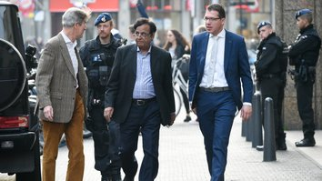 Asia Bibi's lawyer, Saif-ul-Malook (centre), arrives to give a news conference in The Hague November 5, after fleeing Pakistan earlier in the week. He received death threats after defending Bibi before Pakistan's Supreme Court. [JOHN THYS/AFP]
