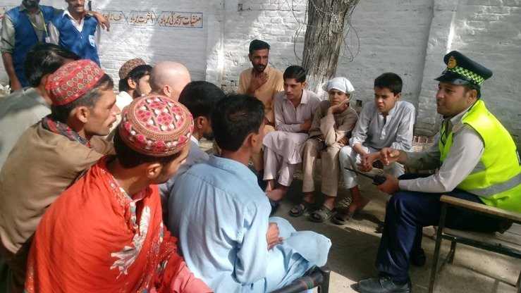 A police official talks with recovering drug addicts at a rehabilitation session arranged by Naway Jwand at a police station in Mingora, Swat, in October. [Naway Jwand]