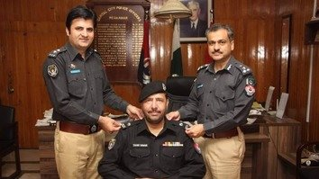 Tahir Khan Dawar, the reportedly slain KP Police officer, receives a promotion from Capital City Police Officer Qazi Jamil ur Rehman and Senior Superintendent of Police Javed Iqbal in August. [KP Police]