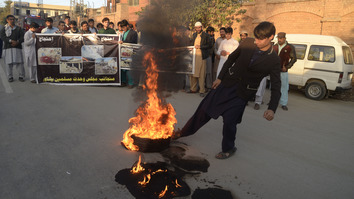 Activists set tires on fire November 23 outside the Peshawar Press Club to protest a deadly ISIS-claimed bombing in Kalaya, Orakzai tribal district. [Shahbaz Butt]