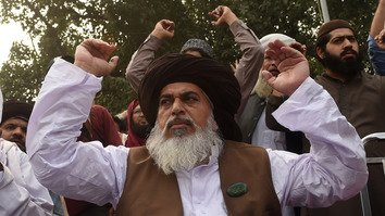 Khadim Hussain Rizvi, head of Tehreek-e-Labaik Pakistan (TLP), a hardline religious political party, gestures in Lahore November 1 as he leads a sit-in protest following the Supreme Court acquittal of Christian woman Asia Bibi. Rizvi was arrested November 24 and charged with sedition and terrorism. [Arif Ali/AFP]
