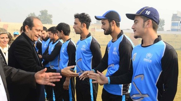Commissioner for Afghan Refugees in KP Muhammad Abbas Khan greets Afghan players in Peshawar December 5. [Shahbaz Butt]