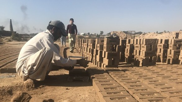 A brick kiln worker stacks bricks in Fateh Jang Tehsil, Punjab Province, December 1. [Nazar ul Islam]