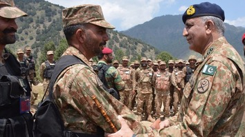 Pakistani Chief of Army Staff Gen. Qamar Javed Bajwa August 4, 2017, in Rajgal Valley, Khyber Agency, talks to an unidentified soldier. Bajwa went to the valley to assess the progress of Operation Khyber-IV. [Maj. Gen. Asif Ghafoor/Twitter]