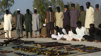Arrested suspected militants and their recovered weapons are presented to the media by Pakistani paramilitary forces at a security compound in the Jamrud area of the Khyber Agency tribal area on March 3, 2017, during the ongoing military 'Operation Radd-ul-Fassad' [Abdul Majeed/AFP]