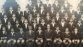 """Saddened to learn of the passing of my teacher,"" Prime Minister Imran Khan tweeted January 2, alongside a class photograph from Aitchison College, where Maj. Geoffrey Douglas Langlands was a long-time teacher and headmaster. [Prime Minister Imran Khan/Twitter]"
