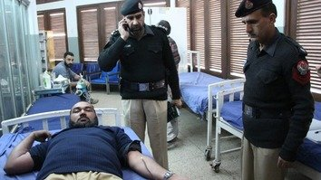 A policeman donates blood January 5 after a blast in Peshawar. [KP Police]