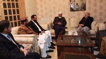 Afghan President Ashraf Ghani's special envoy for regional affairs and peace, Mohammad Umer Daudzai (right), who led a delegation to Pakistan January 8-11, confers with Jamaat-e-Islami Pakistan chief Siraj ul Haq (next to Daudzai) in Islamabad January 10. [Jamaat-e-Islami Pakistan/Twitter]