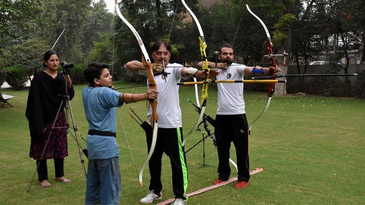 Sarah Khan trains players at her archery club in Peshawar in November. [Muhammad Shakil]