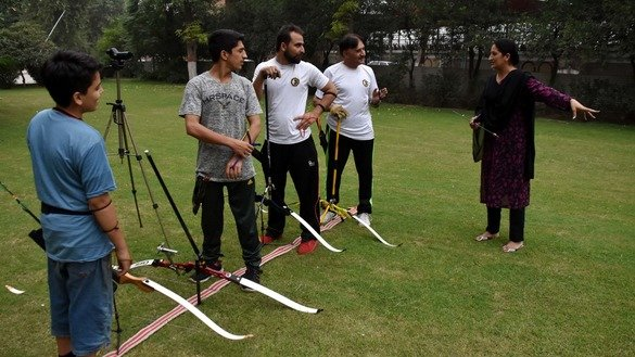 Sara Khan teaches archery to both male and female students at her sports club in Peshawar. [Muhammad Shakil]