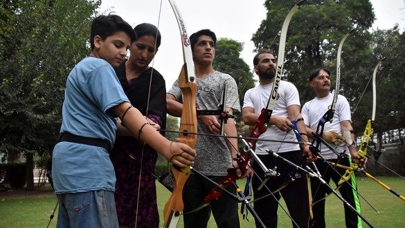 Archery instructor Sara Khan teaches students how to hold a bow and arrow in Peshawar in November. [Muhammad Shakil]