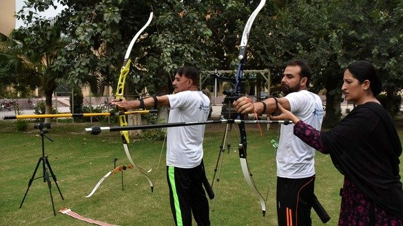 Sara Khan trains students on bow and arrow techniques in Peshawar in November. [Muhammad Shakil]
