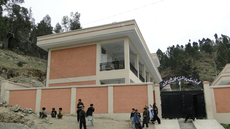 Students play outside a newly reconstructed boys' school in Swat March 25. [Syed Ansar Abbas]