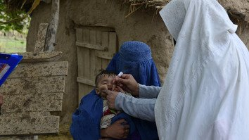 Vaccination workers immunise children in the tribal districts February 27. [KP Health Department]