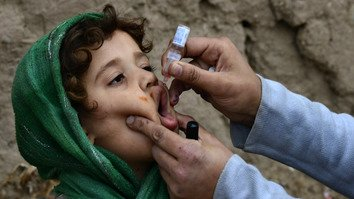 A polio vaccinator vaccinates a child February 27 in the tribal districts. [KP Health Department]