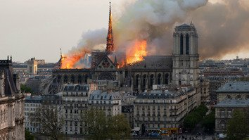 Flames and smoke are seen billowing from the roof at Notre Dame Cathedral in Paris on April 15. [Fabien Barrau/AFP]