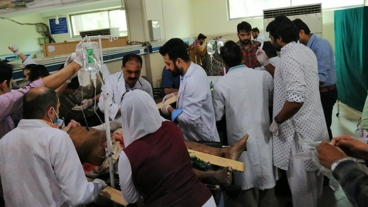 Medical staff provide first aid in a hospital May 8 to a survivor of the suicide bombing outside Data Darbar in Lahore. [Abdul Nasir Khan]