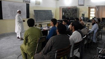 Youth receive technical training as part of the Chief Minister Youth Training Programme at Technical Training Centre Gulbahar in Peshawar May 15. [Muhammad Shakil]