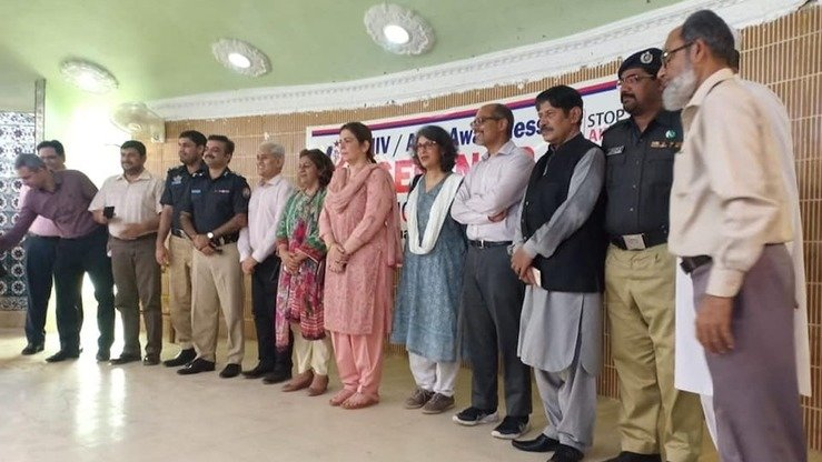 Larkana District residents and civil society activists May 11 attend an HIV awareness camp organised by the police. [Zia Ur Rehman]