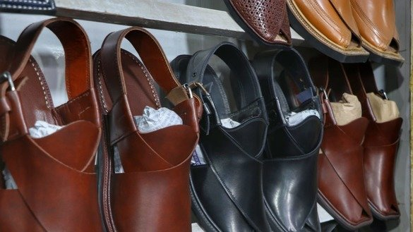 Shoes of different colours are showcased in Peshawar on May 24. [Alamgir Khan]