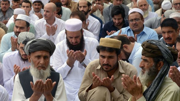 Peshawar residents pray on June 4. [Shahbaz Butt]