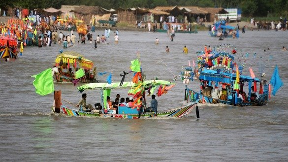 Khyber Pakhtunkhwa residents celebrate Eid by riding boats in Charsadda District on June 4. [Shahbaz Butt]