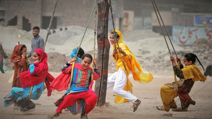 Children play during Eid ul Fitr near Peshawar on June 4. [Shahbaz Butt]