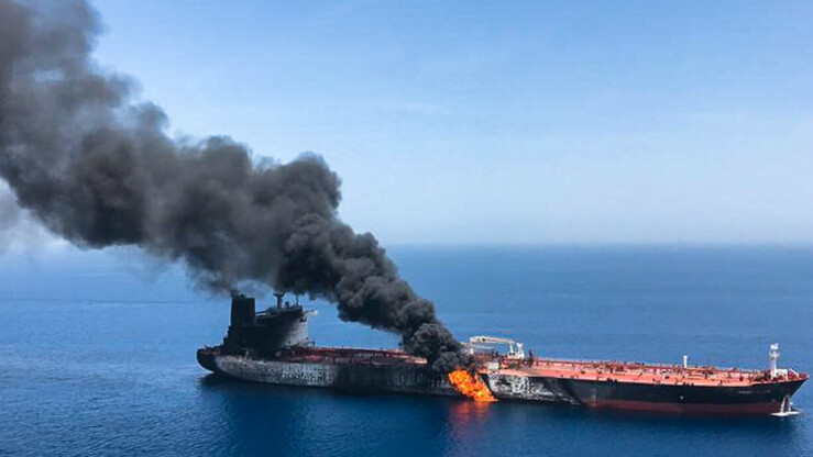 Smoke billows from the Norwegian-owned Front Altair tanker after it was attacked in the Gulf of Oman on June 13. [ISNA]