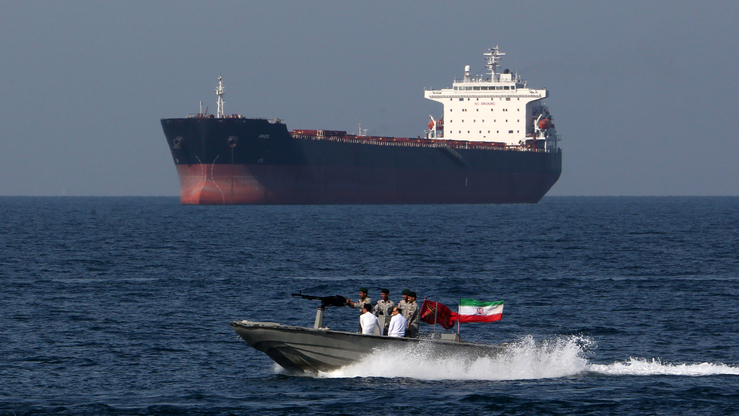 "Iranian troops take part in ""National Persian Gulf Day"" in the Strait of Hormuz on April 30. [Atta Kenare/AFP]"