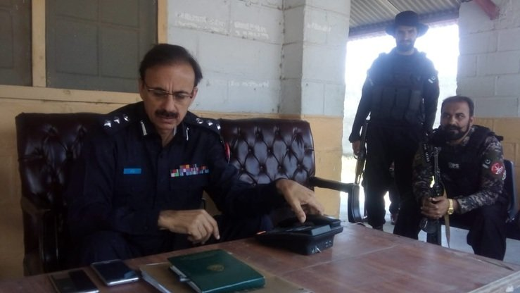 Police officials sit inside the first police station in South Waziristan June 10. [Courtesy of Syed Ansar Abbas]
