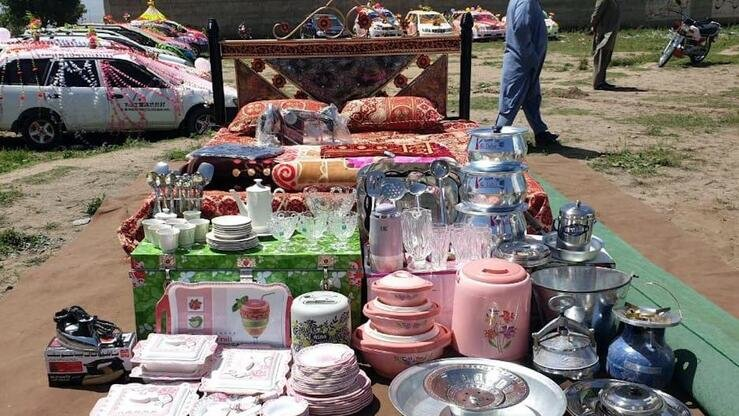 Household utensils and furniture given as dowries to brides during a collective marriage ceremony are put on display on April 28 in Parachinar by the Sahiban Trust. [Sahiban Trust]