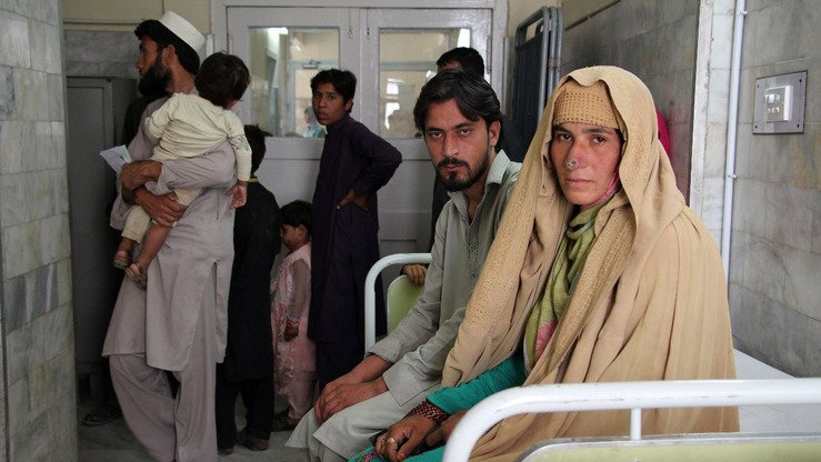 An Afghan woman with leishmaniasis awaits treatment at Naseerullah Khan Babar Memorial Hospital in Peshawar January 13. [KP Health Department]