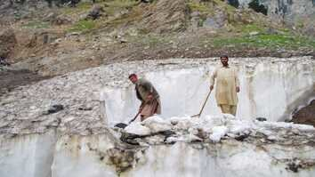 In photos: Chitral residents beat summer heat with glacier ice