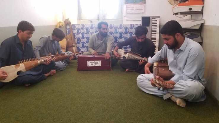 Students June 8 learn music at the first ever music academy in Parachinar. [Courtesy of Syed Ansar Abbas]