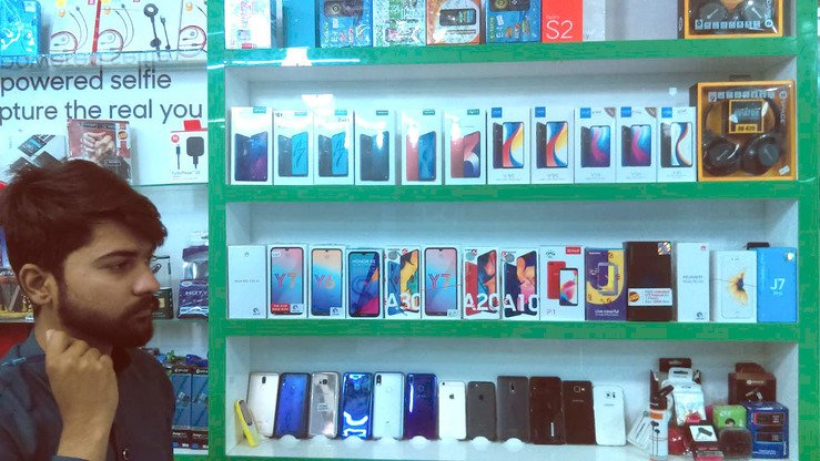 A smartphone merchant in the Blue Area market in Islamabad June 2 displays products made by Huawei and other brands. [Javed Mahmood]